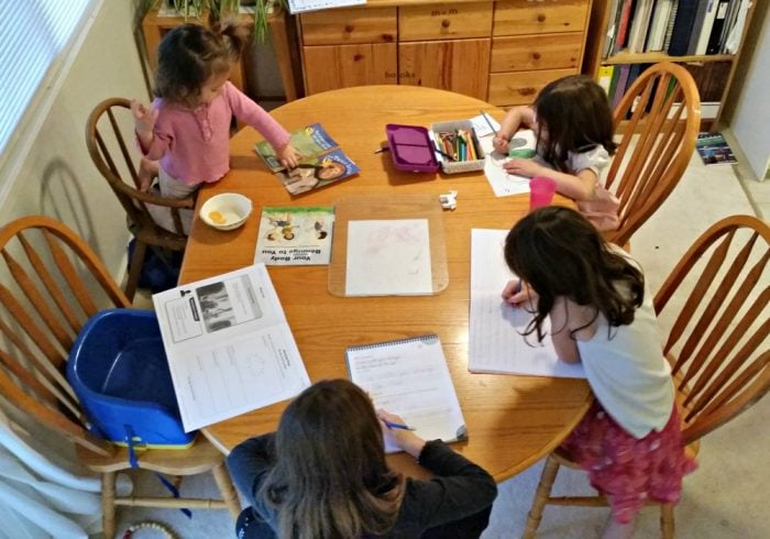 Homeschooling multiple ages at the dining room table!